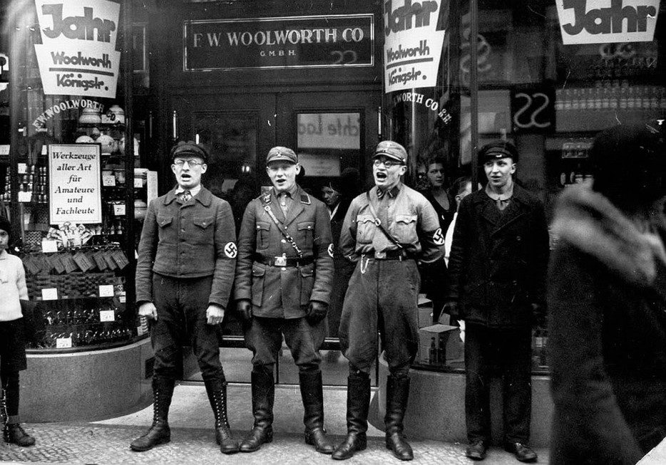 Nazis%20singing%20outside%20of%20Jewish%20art%20shops%20to%20encourage%20Germans%20to%20boycott%20the%20shops.%20%5B1933%5D