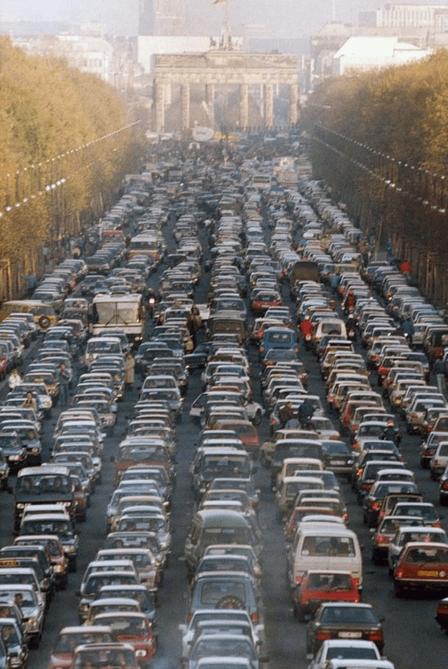 19.) 1989 - Traffic jam in Berlin as the border between East and West Germany opens.