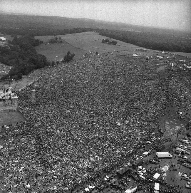 17.) 1969 - Crowds at the original Woodstock Music Festival.