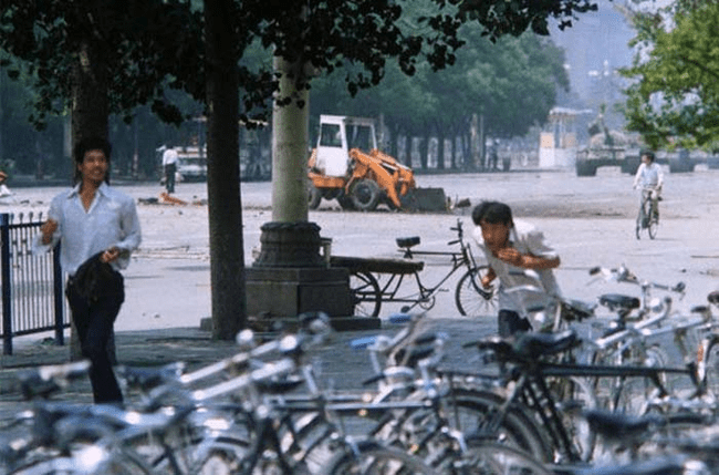 4.) 1989 - The Tank Man in Tiananmen Square, China. He's to the left of the bulldozer.
