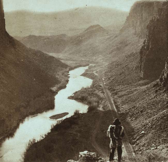 21.) 1868 - A Native American observers the completed Transcontinental railroad.