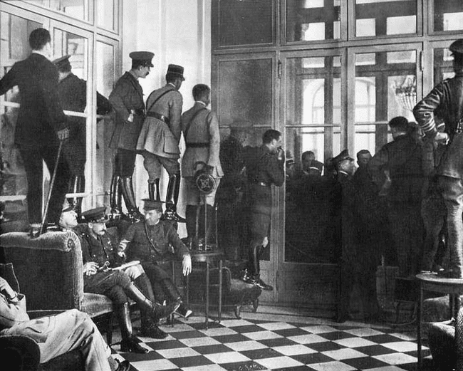14.) 1919 - Spectators watch the signing of the Treaty of Versailles.