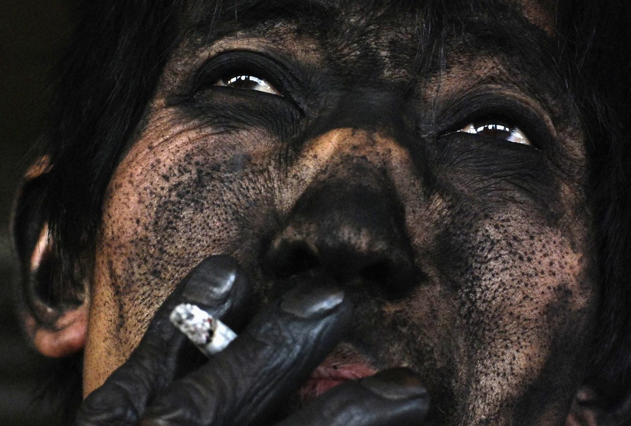 The face of a Chinese coal miner.