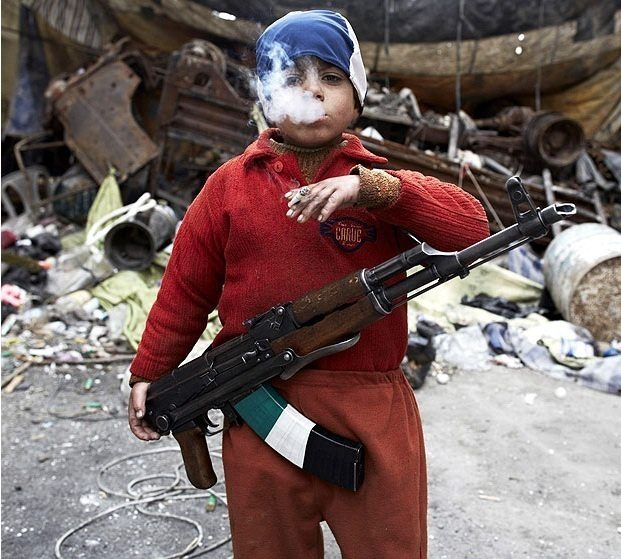 7-year-old Syrian rebel.