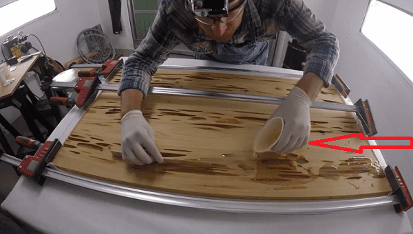 He pours resin on this piece of wood to create something - Glow in the dark resin table ...