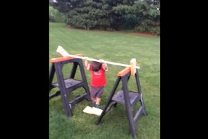 toddler plays obstacle course