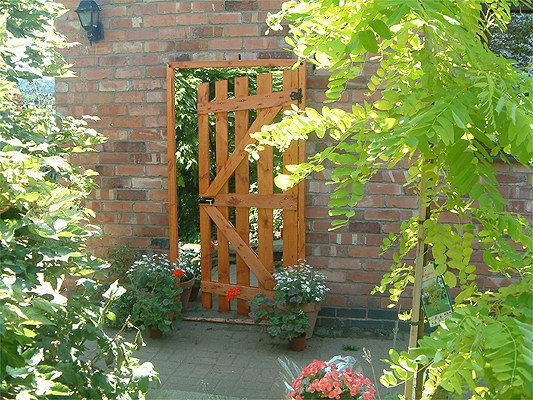 """If you've always wanted a """"secret garden,"""" a mirror in the backyard creates that illusion."""