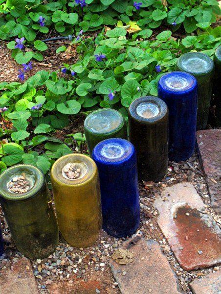 Upside-down wine bottles are a creative way to do garden edging.