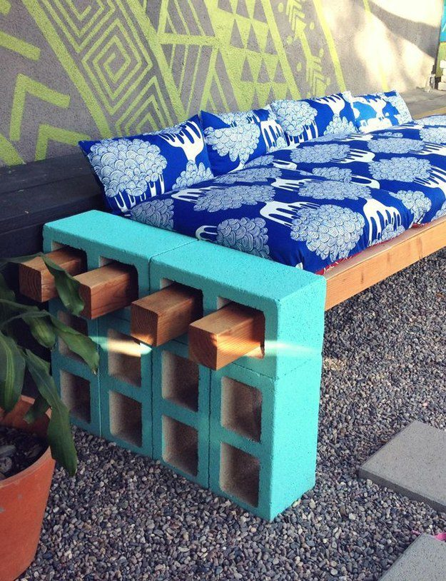 With a few long pieces of wood, you can also use cinder blocks to create an impromptu couch.