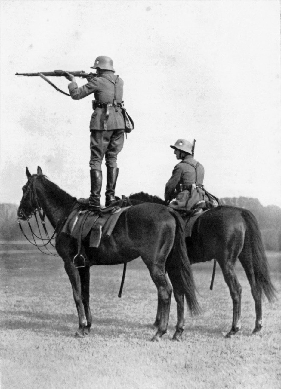 A%20German%20soldier%20firing%20a%20gun%20from%20the%20back%20of%20his%20horse.%20%5B1939%5D