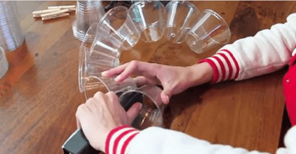 As She Staples Plastic Cups Together, It Becomes Amazingly ...