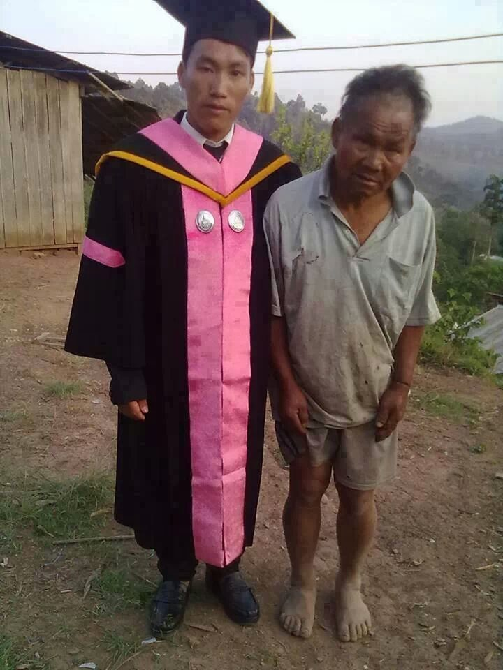 A farmer with his son who just graduated.