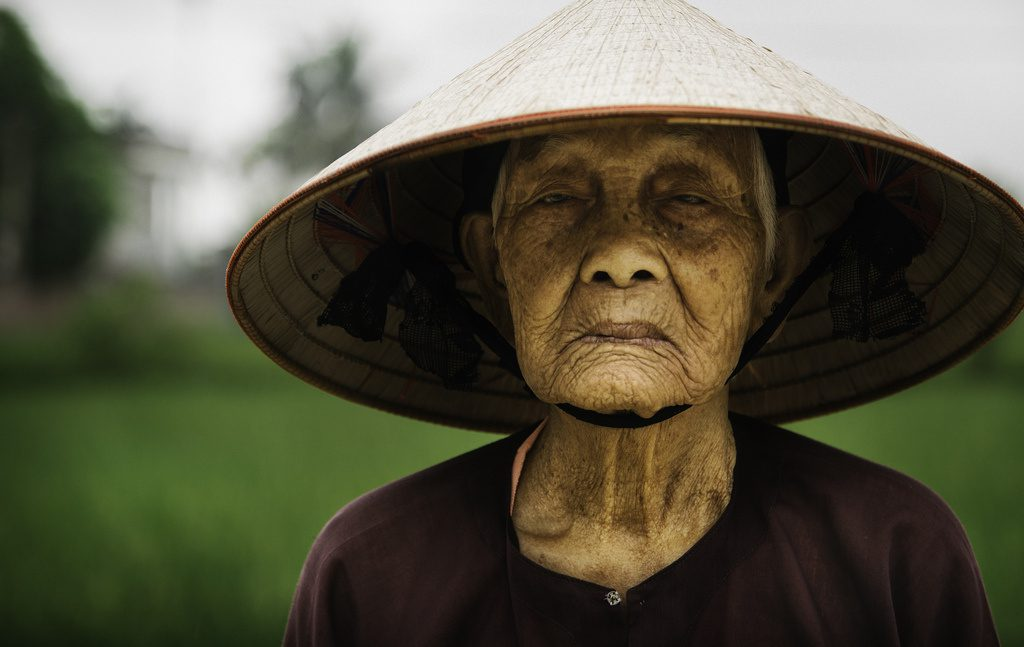 Rice farmer in small village in Vietnam.