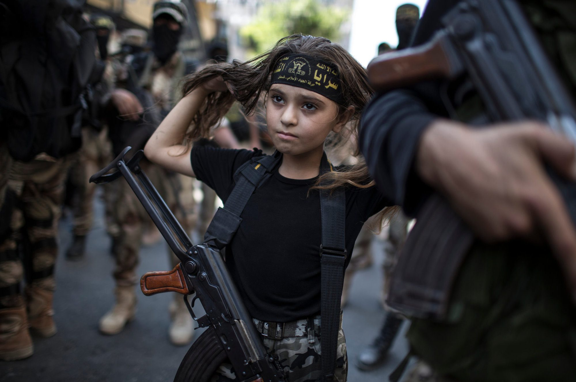 A Palestinian girl with an AK-47 in Gaza City.