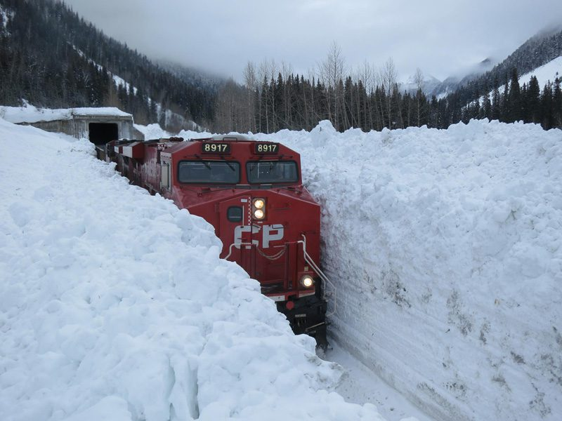 train-going-through-huge-snow-wall-in-canada