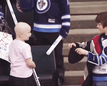 Boy gives hockey stick to cancer-fighting girl